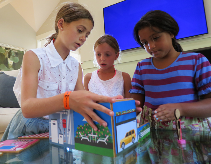 Friends build a dollhouse with Build & Imagine StoryWalls.