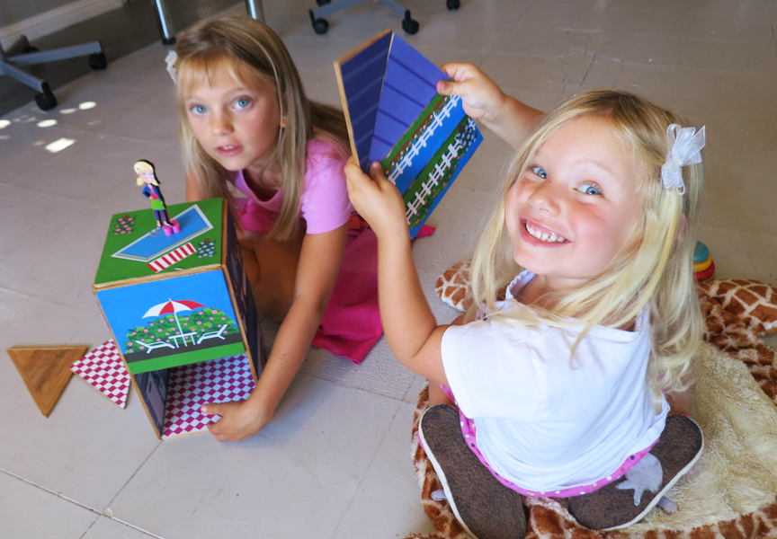 Sisters build with Build & Imagine play-sets.